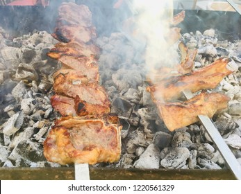 Barbecue on the grill. Shashlik made of cubes of meat on the skewers during of cooking on the mangal over charcoal outdoors.Baku,Azerbaijan