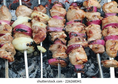 Barbecue on skewers in the end of the cooking process
