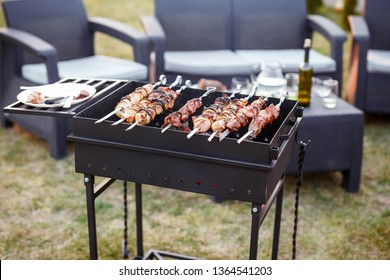 Barbecue on the street. Brazier and cooking kebabs. Grilled meat in the open air