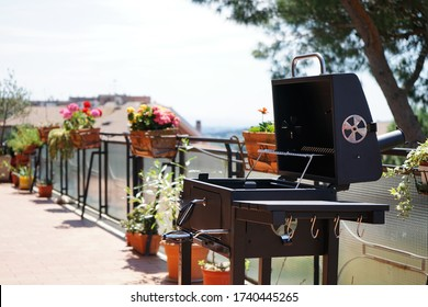 Barbecue on the terrace with many flowers and a beautiful view