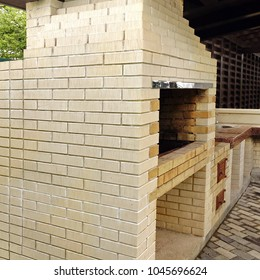 Barbecue Open Fireplace For  Cookout Food. Party Family Place. Outdoor BBQ Grill. Open Summer Kitchen. Barbeque Grill Made From Bricks On The Backyard