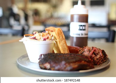 Barbecue plate with pork ribs, beef brisket, and Texas toast.