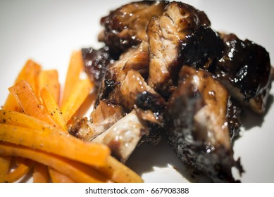 Barbecue Pork grill with carrots on white plate