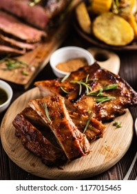 Barbecue pork rib with spices and baked potatoes