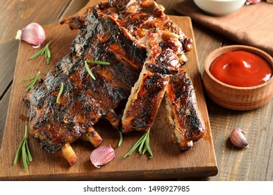 Barbecue pork ribs on cutting board, close up view
