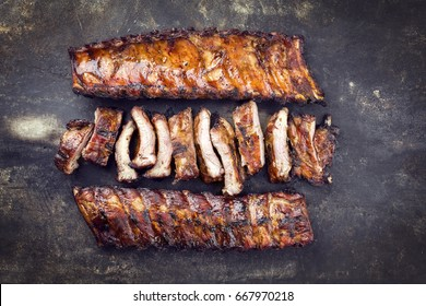 Barbecue Pork Spare Ribs as top view on an old rusty metal sheet