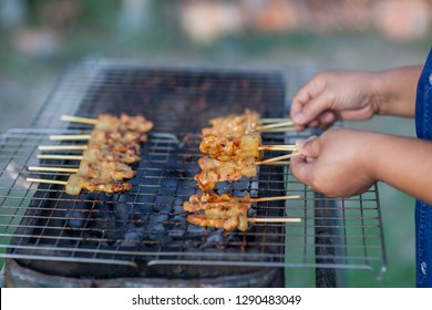 Barbecue pork Toast grill or Toast pork with Thai garnish nutrition preparation for cooking. Thai food, Street food.Pork satay grilling on stove or Thai style roasted pork at the market.