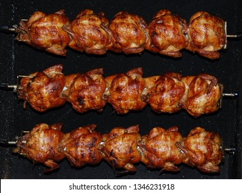 Barbecue roast Chicken in a row turning at industrial roaster