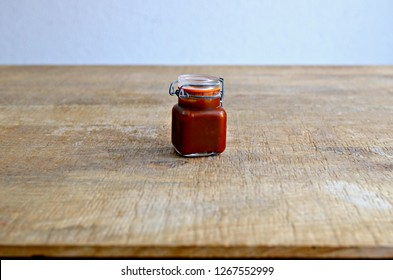 Barbecue sauce jar on wooden table