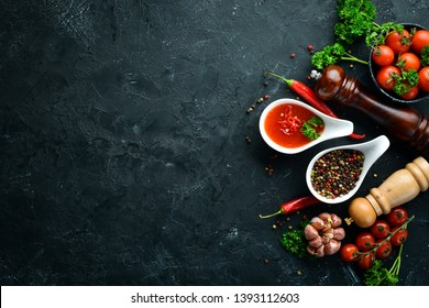 Barbecue sauce. Tomatoes, spices and herbs. Top view. Free space for your text.