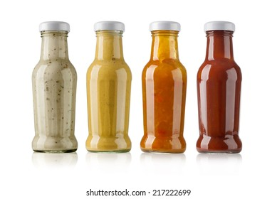 barbecue sauces in glass bottles on white background
