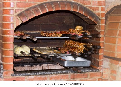 Barbecue skewer with meat, chicken, pineapple, sausage and bread roasting on the grill