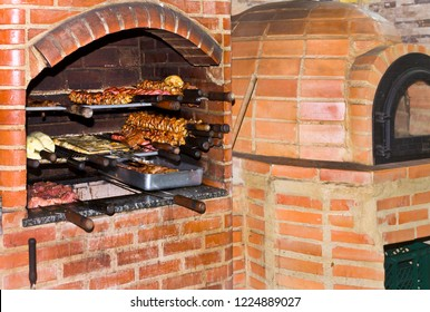 Barbecue skewer with roasting beef on the grill and baking oven pizza