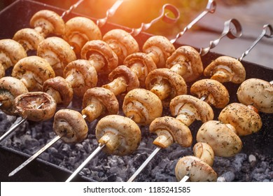 Barbecue skewers with delicious grilled champignon mushroom kebab in a brazier