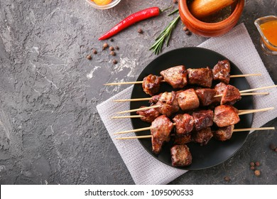Barbecue skewers with juicy meat on plate