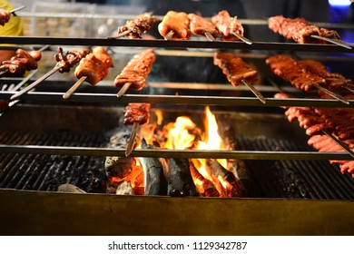 Barbecue skewers meat with vegetables on flaming grill
