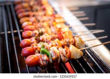 Barbecue skewers with vegetables  on the grill