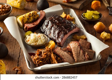 Barbecue Smoked Brisket and Ribs Platter with Pulled Pork and Sides