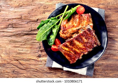 Barbecue spare ribs on an rustic wooden table