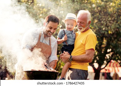 Barbecue time.Happy big family make barbecue in their garden.