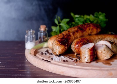 Barbecue tongs with sausages