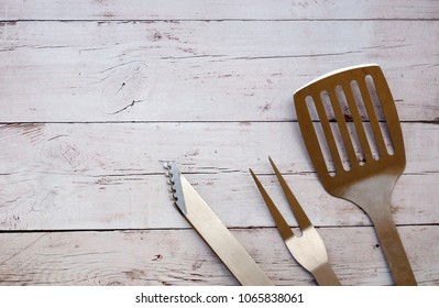 Barbecue tools on a wooden background for Israeli independence day