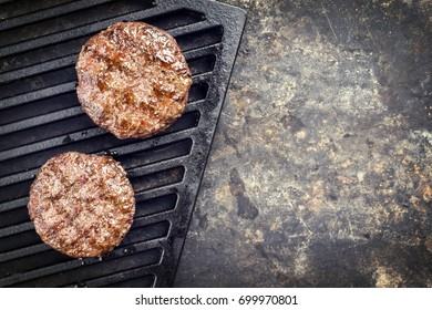 Barbecue Wagyu Hamburger as top view on a grillage with copy space right