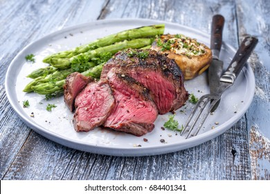 Barbecue Wagyu Point Steak with green Asparagus and Mushroom Cap as close-up on a plate