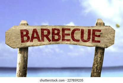 Barbecue wooden sign with a beach on background