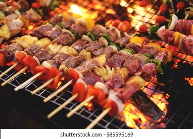 barbecue,Bar-B-Q,Barbeque Grill Street Food in thailand,market and Pork BBQ Skewers