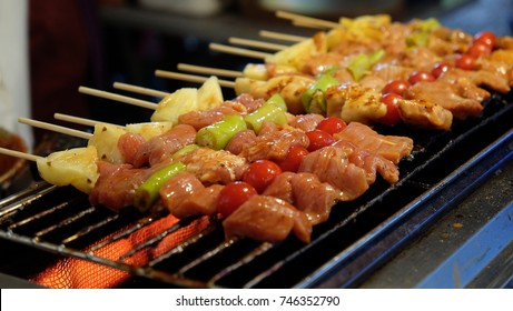 barbecue,Bar-B-Q,Barbe-que Grill Street Food in Thailand,market and Pork BBQ Skewers