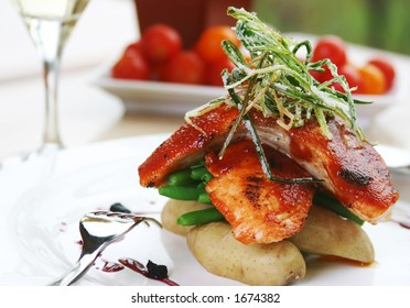 Barbecued atlantic salmon with wildberry reduction & haricot verte. Shallow DOF.