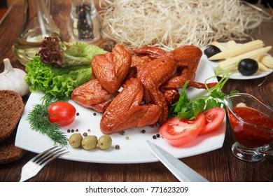 Barbecued chicken drumsticks and vegetables.