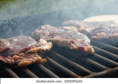 Barbecued Meat on Charcoal Grill