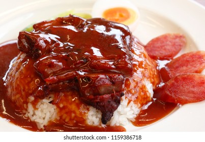 Barbecued red pork in sauce with rice. Rice with roasted red pork in sauce.