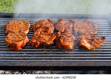 Barbecued steak on the grill.