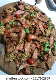 Barbecued steak with wholegrain mustard. Ready to serve