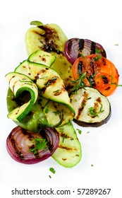 Barbecued tomato, zucchini and other vegetable isolated on white background