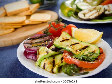 Barbecued zucchini, tomato and onion served on a plate