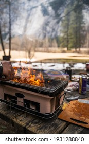 barbecuing in the winter time with snow around the japanese grill for great meat and flavors at Yosemite national park
