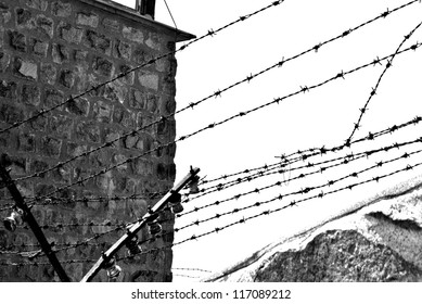 Barbed top of wall at the Nazi work camp of Mauthausen In Austria.