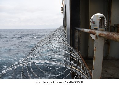 Barbed wire attached to the ship hull, superstructure and railings to protect the crew against piracy attack in the Gulf of Guinea in West Africa.