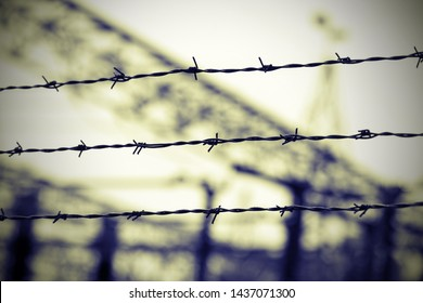 barbed wire in the concentration camp with old effect toned and the background blurred