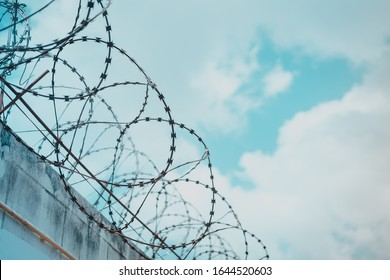Barbed wire fence attached around prison walls and Border wall for protection corona virus.Wuhan coronavirus and epidemic virus symptoms.Worldwide virus symptoms.Close city.Close countries concept.