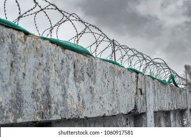 barbed wire fence birth enclosing the prison and places of detention for prisoners punished for committing criminal offences