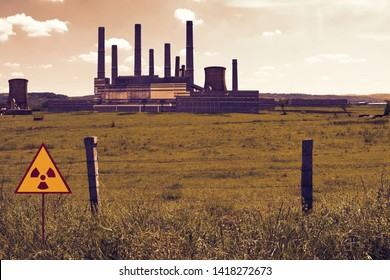 Barbed wire fence and radioactive sign on the nuclear chemical power plant's field in Chernobyl Pripyat atmosphere. Exclusion restricted area in a scary scene. Dramatic color  view