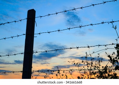 Barbed wire fence with Twilight sky