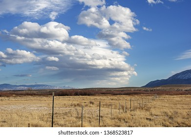 barbed wire fence and wave cloud forming over the Owens Valley near Bishop California