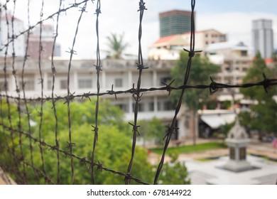 Barbed wire in memorial prison museum building in Cambodia close to Phnom Penh Pol Pot Holocaust