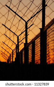 Barbed wire on sunset background